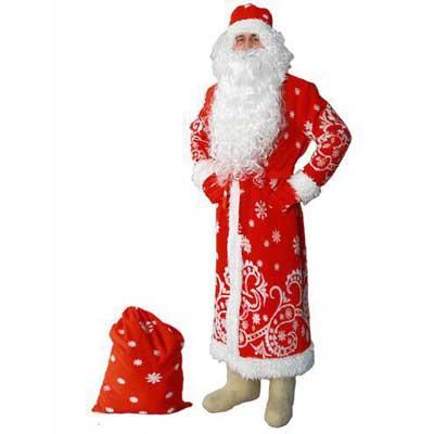 Дед Мороз рядом с мешком для подарков.